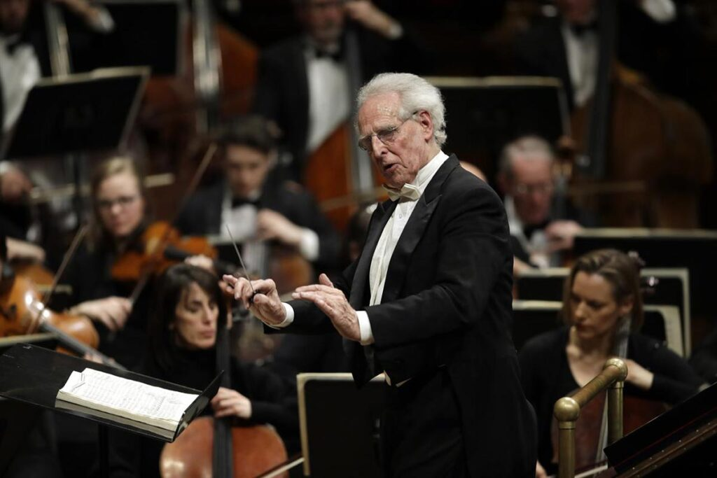 Benjamin Zander leading the Boston Philharmonic Orchestra, which he founded in 1979.